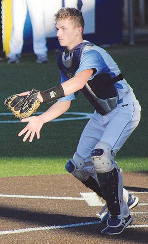 Jonathon Cole prepares to make a play at the plate during a Bartlesville High baseball last spring.