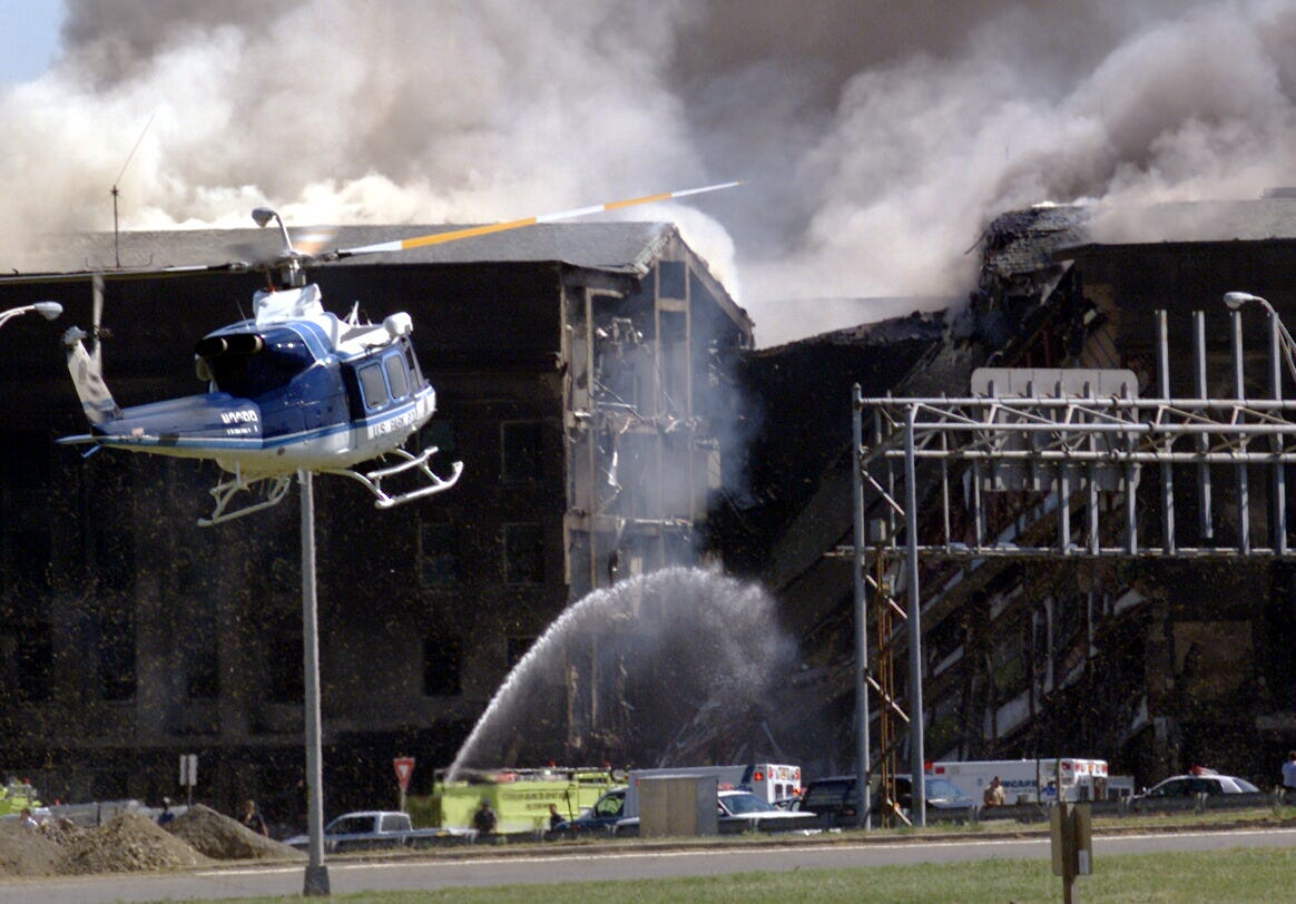 A U.S. Park Police helicopter arrives the Pentagon after picking up casualties of the plane crash in a terrorist attack.