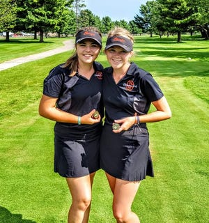 From left, Cheboygan's Jenna Webber and Katie Maybank both earned medals after finishing in a tie for eighth place overall at the season-opening Grayling Invitational on Monday.