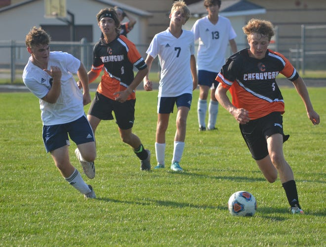 Cheboygan junior forward Connor Gibbons, right, heads up the field with the ball during the second half of a varsity boys soccer contest against Roscommon in Cheboygan on Monday. Gibbons' first-half goal allowed Cheboygan to earn a 1-0 victory over the Bucks.