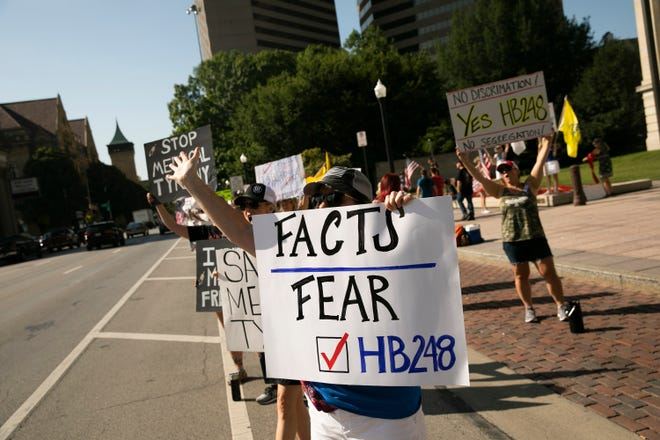 Supporters of House Bill 248, which would prohibit employers from requiring vaccines among other provisions, gathered outside the Ohio Statehouse on Tuesday.