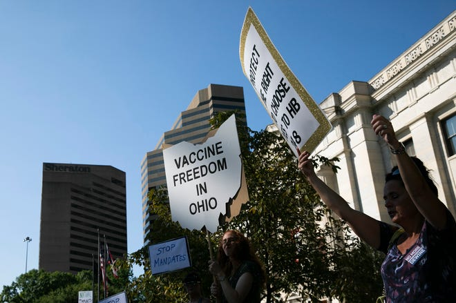 Supporters of House Bill 248, which would block employers from requiring vaccines for workers, gathered outside the Ohio Statehouse in August. Legislative leaders delayed action on the bill but supporters are now pushing for an immediate floor vote.