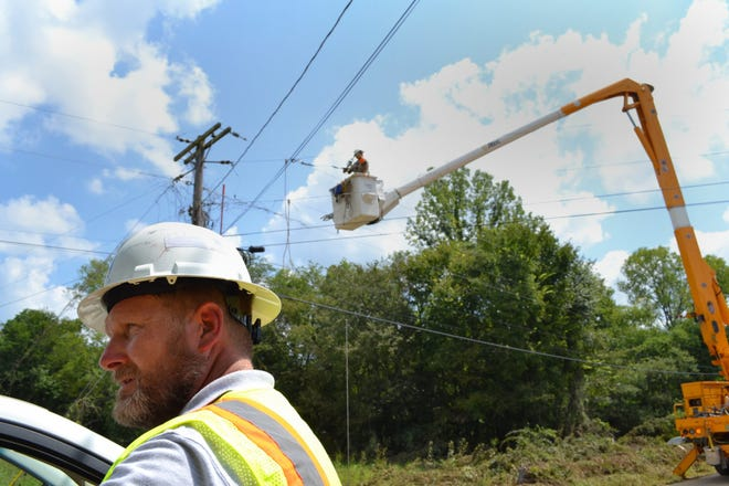 Crews with the Meriweather Lewis Electric Cooperative continue to repair powerlines after a heavy storm led to deadly floods in Middle Tennessee in August 2021.
