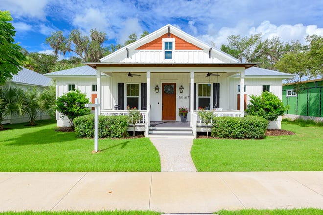 This highly sought-after 2019 Hickson Construction home is in the beautiful New Smyrna Beach community of Florida Days.