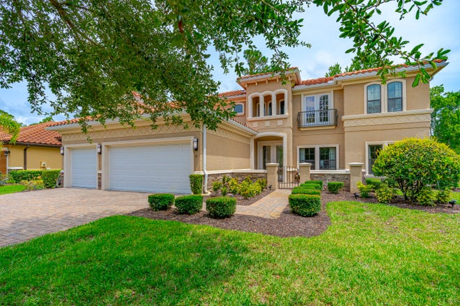 This beautifully finished Mediterranean-style home is located in the much sought-after community of Il Villaggio.