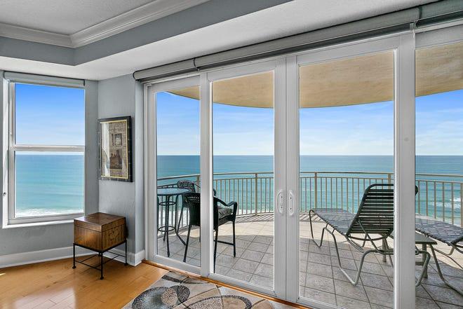 Enjoy the luxury of unobstructed coastline views through walls of windows in this custom-built condominium estate in Daytona Beach Shores' prestigious St. Maarten community.