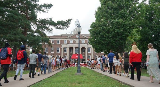 New students at Monmouth College make their way to their seats in front of Wallace Hall for the matriculation ceremony that officially marks the beginning of their four years on campus.