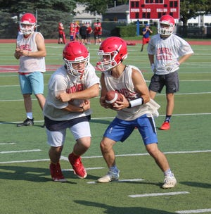 Hornell's Dom Nasca pulls back the handoff during a drill on Monday afternoon on Day one.