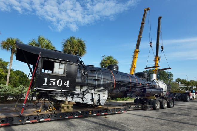 The main boiler section of the 101-year-old Atlantic Coast Line steam locomotive No. 1504 that sat outside the Prime Osborn Convention Center since 1989 is strapped to a flatbed trailer as it and the rest of its sections heads to a Tennessee restoration shop Tuesday. When restored, it will run at U.S. Sugar's Sugar Express railroad museum in Clewiston.