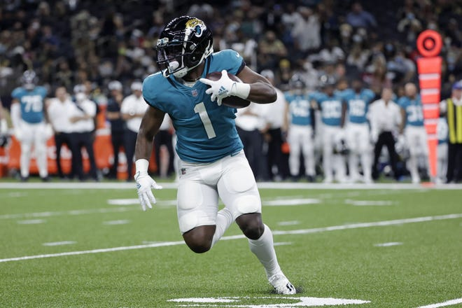 Jaguars running back Travis Etienne carries the ball during the first half against the Saints on Monday night.