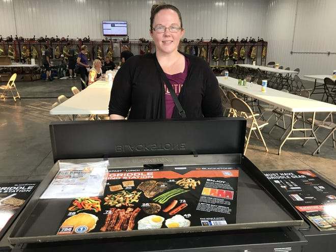 Pictured is Amy Hudson the winner of the grill from the Galva Firemen's Hog Roast raffle held Saturday Aug. 21 at the fire station. Hudson was the only winner present. Other winners were: blue tooth speaker, Brent Hall; Yeti cooler, Ann Good; cutting board, David Dyer;  cast iron pan, Lindsey Werkheiser;  and a table hutch, Carlin Follis.  The 50/50 drawing was won by Heidi Martin and gave it all back to the Galva Fire Department. Over 500 meals were served.  Firemen were very pleased with their turnout and profit for the evening.               Virus-free. www.avg.com