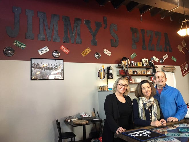 Jim McCormick poses with his wife Debra, center, and daughter Katherine before the opening of the new Jimmy's Pizza on East Tompkins Street in January 2019.