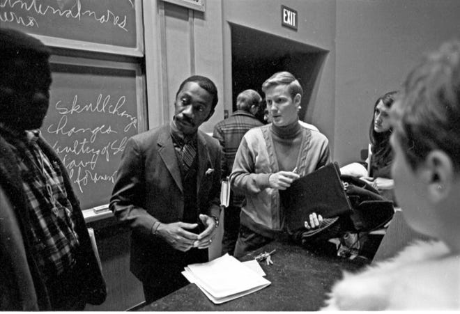 Indiana University professor James Holland talks with students in 1970.