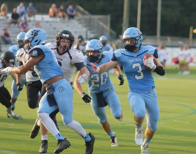 East Duplin's Avery Gaby (3) follows his blockers for a big gain Monday night in the Panthers' 67-6 win over Dixon.