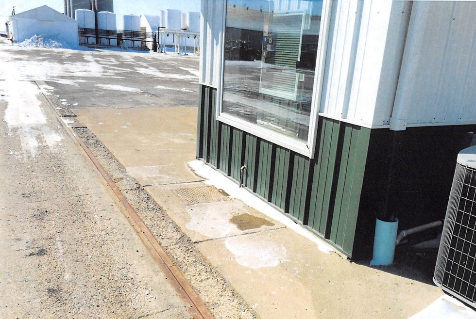 This photograph, filed as part of the court record, shows the area outside of the Roanoke office of Providence Ag, where company general manager Rodrick Studer fell into an open manhole in 2014, breaking his foot and injuring his back. He sued Central Illinois Scale Co., which was performing work at the site, claiming it should have had warning signs placed around the area. An Illinois appellate court recently reinstated Studer's lawsuit.