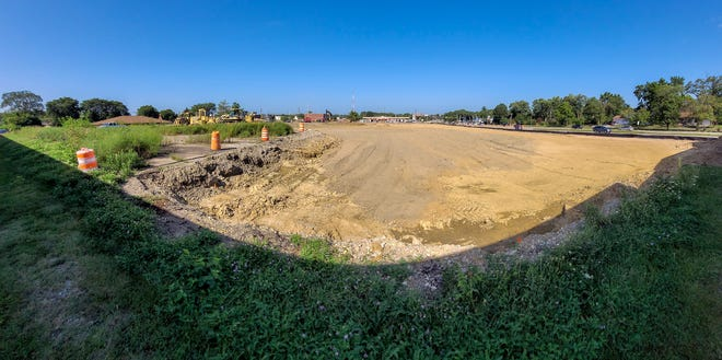 The old site of Jim McComb Chevrolet at University Street and War Memorial Drive has been cleared for construction of a new financial institution on part of the long-vacant lot.