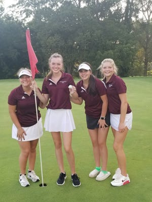 Princeville's Audrey Bowermaster, second to left, holds her golf ball following a hole-in-one on Monday. The junior recorded an ace in just her second high school golf meet ever. She's joined on the 17th green, left to right, with her playing partner, Kiara Cihla, Bridget Gilroy and Paisley Schock. Not pictured is team member Neleh Geiger.