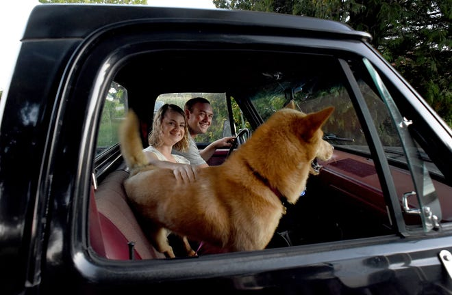 Holly and Tye Thompson hop in their 1987 Dodge Ram pickup as they head out for date, a weekly tradition for recently married couple. They are joined by their dog, Bella, who they rescued.
