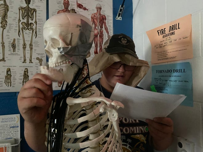 """Incoming Airport High School freshman Jacob Turner Kiser performs a skit, using a science room skeleton as a prop, that's based on the short story, """"The Boo Hag,"""" a Georgia folktale, during his summer school English Language Arts class.   Photo by CAITLIN BORON"""