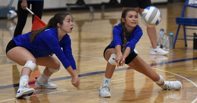 Ida's Krista Schroeder and Kaylee Stein go down for the dig during Lenawee County Athletic Association pool play at Dundee on Tuesday.