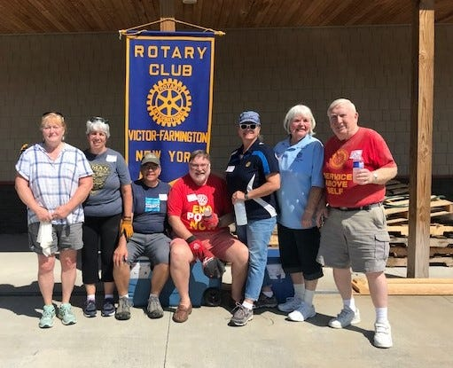 Victor-Farmington Rotarians build beds for children in need.