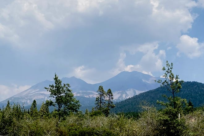 """Mt. Shasta was once described by Joaquin Miller as """"lonely as God, and white as a winter moon."""" For the first time in recent memory, Mt. Shasta's western side is devoid of snow on Aug. 5, 2021."""