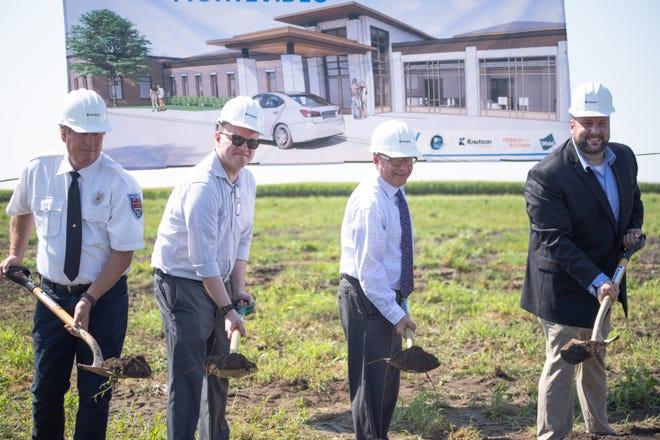 Montevideo City officials Mitch Steuck, Robert Wolfington, Mayor Erich Winter, and Ben Dolan take part in the groundbreaking ceremony.