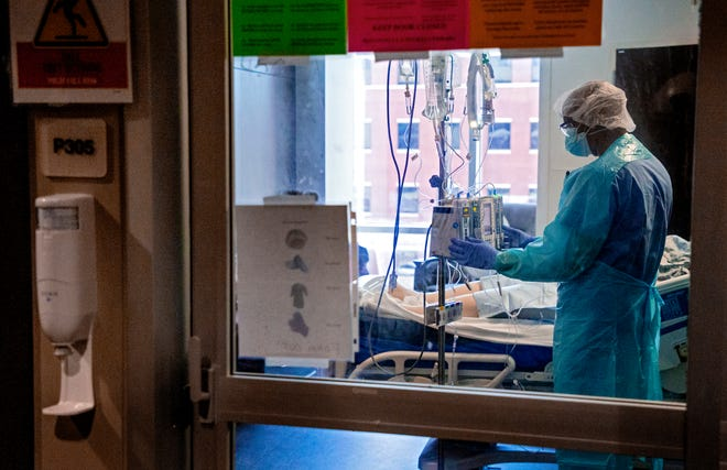 A nurse gives care to a patient in the COVID ICU at SSM Health St. Anthony Hospital in Oklahoma City, Okla. on Tuesday, Aug. 24, 2021.