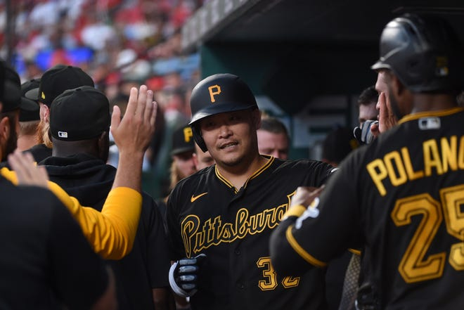 Pittsburgh Pirates outfielder Yoshi Tsutsugo, center, is congratulated after hitting a home run against the St. Louis Cardinals over the weekend. Tsutsugo played 43 games with the Oklahoma City Dodgers before he was released on Aug. 14. He has three home runs for the Pirates.