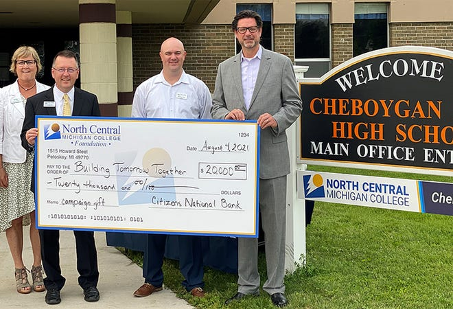 """Representatives from North Central Michigan College and Citizens National Bank participate in a check presentation marking the bank's $20,000 gift to the college's """"Building Tomorrow Together"""" campaign.  Pictured are (from left) Nancy Lindsay, Citizens National Bank's vice president of marketing; North Central Michigan College president David Roland Finley; Christian Smith, NCMC Foundation gift officer and Citizens National Bank president and CEO Matthew Keene."""