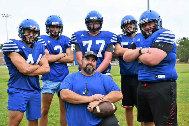 Somersworth football coach Jeremy Lambert, kneeling, is pictured with returning starters from the 2020 season. In the back, from left, are Calvin Lambert, Jeff DeKorne, Cam Dubois, Owen Clark and Jacob Gibson. Missing: Dante Guillory.