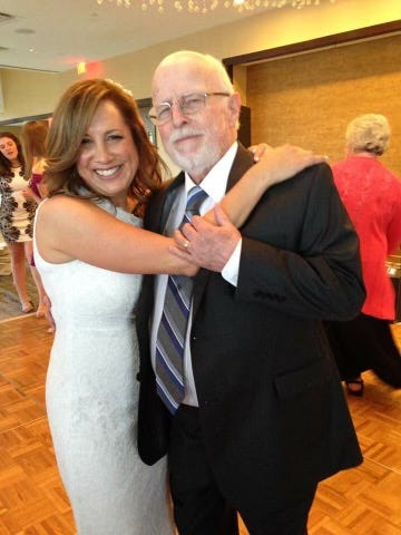 Lisa Post Mazerolle, of Easton, Massachusetts, smiles with her father, David Post, who died of COVID-19 last year.