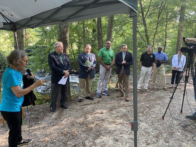 Wendy Austin, left, executive director of the Friends of the Lower Appomattox River, introduces guests during a ceremony at Ferndale Appomattox Riverside Park in Dinwiddie County Tuesday, Aug. 24, 2021. The ceremony was held to announce a $1 million grant FOLAR received from the Petersburg-based Cameron Foundation.
