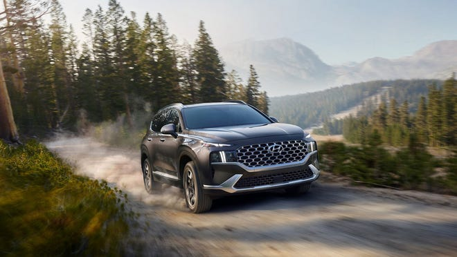 The 2021 Hyundai Santa Fe Limited is powered by a 1.6-liter turbocharged four-cylinder gasoline engine and an electric motor that together deliver 226 horsepower and 258 pound-feet of torque. All-wheel drive is standard.