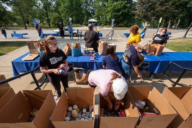 Volunteers accept and sort donated items during Kent State University's 2020 Flashes Fighting Hunger Contactless Food Drive.