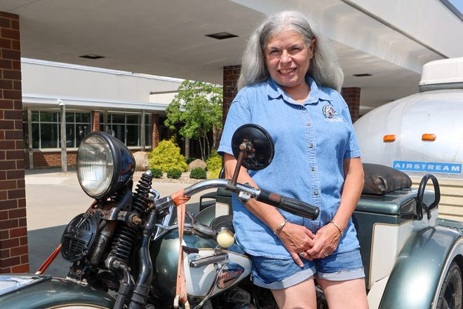 Dr. Denise Rich-Gross, vice president of the Antique Motorcycle Foundation, leans against her 1946 Harley Davidson Servi-Car outside of the Maplewood Career Center in Ravenna.