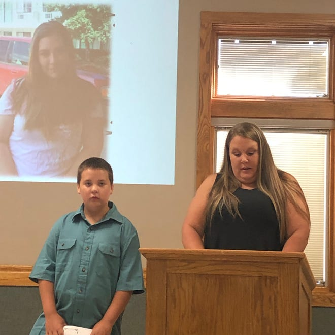 Brianna Lilly's best friend Crystal Fawcett, with Lilly's son Timothy, shares the impact driving drunk has on loved ones during Tuesday's Drive Sober Memorial Checkpoint event in East Canton. A drunken driver killed Lilly, who was walking, in 2018.