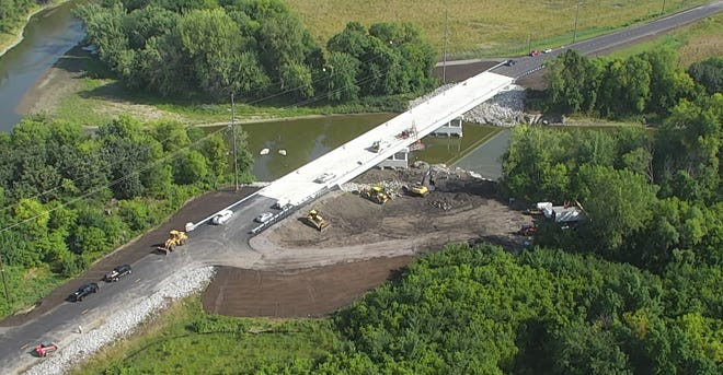 Redwood County CSAH 101 Bridge over the Minnesota River opened to all traffic on Monday evening, Aug. 23. The detour will be removed and the posted speed limit will be 40 miles per hour as the contractor crews finish remaining work on the project which includes bridge guardrail adjustments, erosion control, and work on the DNR Public Water Landing. In order to complete portions of this work, the contractor will reduce the roadway and bridge to one lane at various times. The public to use caution when traveling over the bridge while the contractor finishes the project. Photo from Monday morning, Aug. 23.