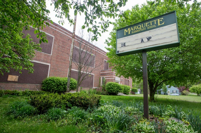 The old Marquette Elementary School building stands vacant on South Bend's northwest side. The city's common council unanimously voted Monday night for a rezoning that a developer needs to create 46 apartments in the former school that's been closed since 2001. Tribune Photo/ROBERT FRANKLIN