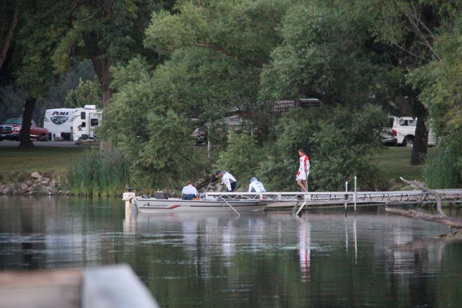 Organizer AJ Arneson chats with a team of bass fishermen as they got on the lake early Sunday morning.