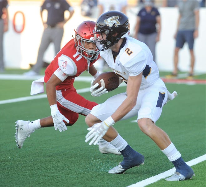 Stephenville's Coy Eakin (2) tries to get around a Sweetwater defender during last year's game at the Mustang Bowl. Eakin is back with the Yellow Jackets this season.