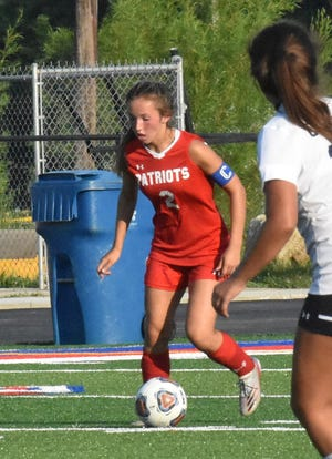 Senior Olivia Wainscott dribbles the ball for the Lady Patriots. Wainscott scored Owen Valley's lone goal against Monrovia, with an assist from Becca Brown.