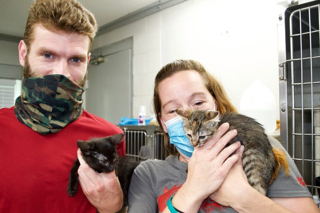 Shaun and Adrean Walker with the kittens they adopted in the 2021 Clear the Shelter effort.
