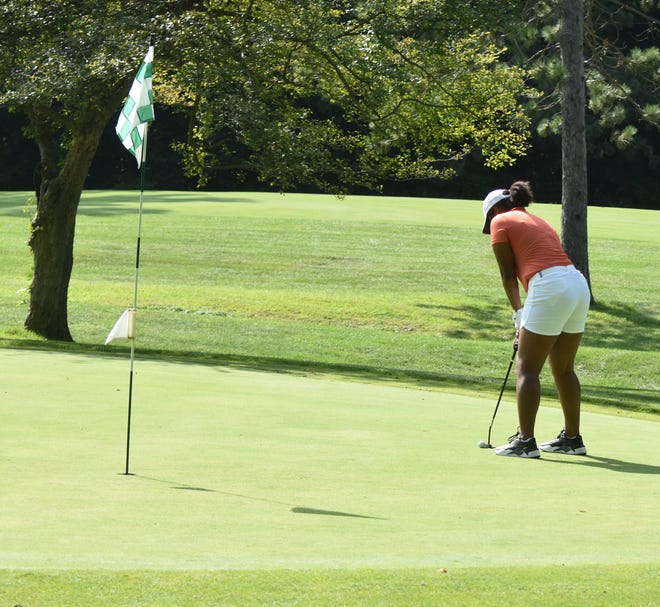 Sturgis freshman Madison Webb lines up a putt during her round at Orchard Hills on Monday.