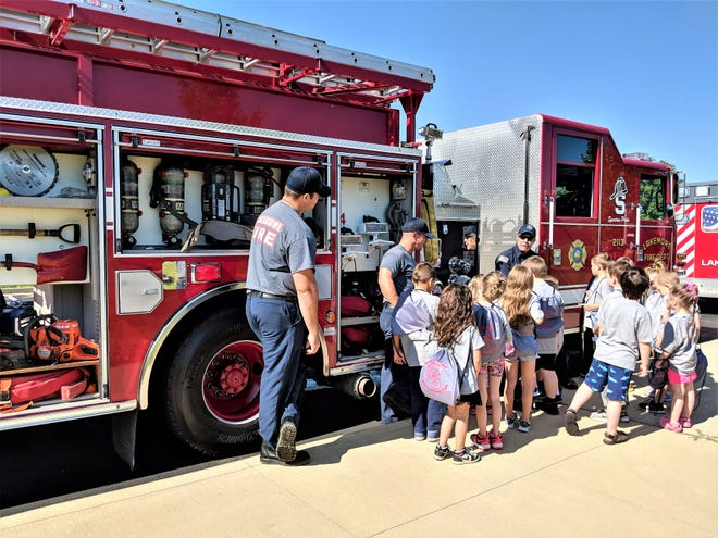 Lakemore firefighters teach children about fire trucks and the different equipment during Safety Town