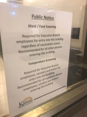 The Department of Administration on Tuesday changed the sign on the governor's mask policy at the Capitol Visitors Center entrance. (Aug. 24, 2021)