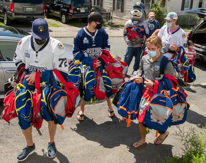Worcester Railers players and staff deliver 120 backpacks filled with school supplies to Friendly House Tuesday.