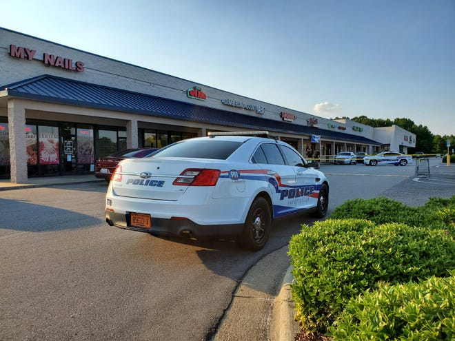 A Fayetteville police car and crime scene tape surround the location of a deadly shooting on South Reilly Road on July 16, 2020.