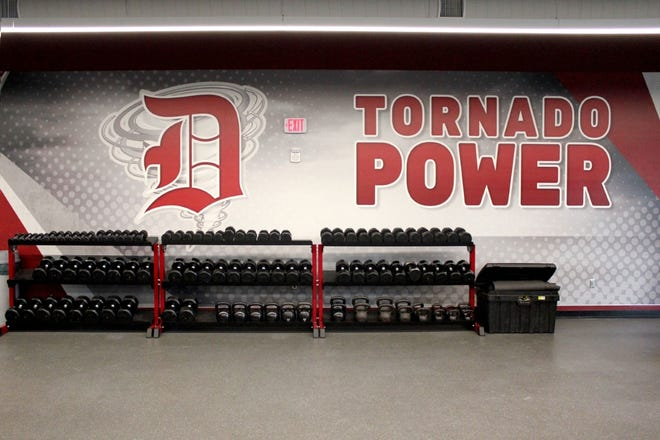 Marlite put inspirational messages on fiberglass-reinforced panels installed on the Dover High School dumbbell wall.