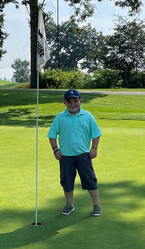 Barrett Stull is pictured moments before retrieving his hole-in-one ball.